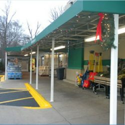 Custom teal storefront awning with white beams