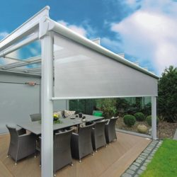 Residential drop-roll awning cover with white awning fabric on a retractable awning