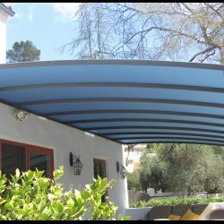 Custom patio cover with light blue awning fabric