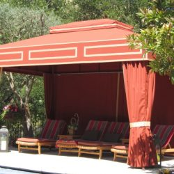 Custom cabana with orange awning fabric