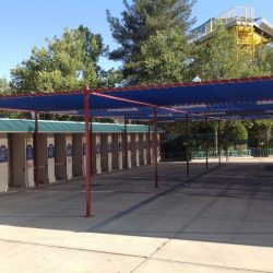 Custom Magic Mountain awning with blue fabric