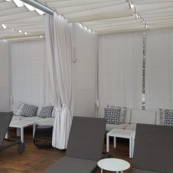 White retractable awning and drapes