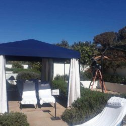 Building custom cabanas in Ojai Valley with blue and white awning fabric