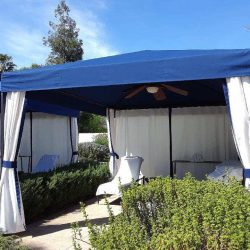 Custom cabana with blue awning fabric and white custom blinds
