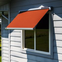 Burnt orange awning fabric on a Sol-Lux smart awning window cover