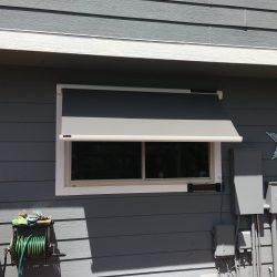 Grey awning fabric on a Sol-Lux smart awning window cover