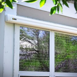 Retracted Sol-Lux smart awning over a window