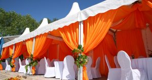 Custom cabana with orange outdoor drapes and white awning fabric