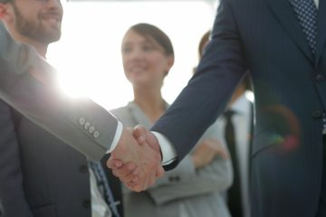 Two businesspeople shaking hands
