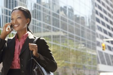 A smiling African-American businesswoman on the phone