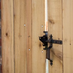 gate latch on wooden fencing