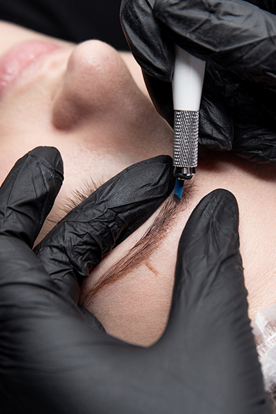 woman getting microblading treatment