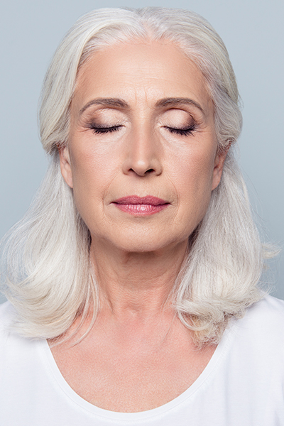 older woman with eyes closed