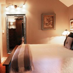 A romantic getaway for two to enjoy the bedroom at The Vineyard Suite.