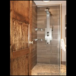 Take a hot, relaxing shower in our luxury cottage rental in Ontario at The Vineyard Suite.