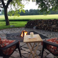 Relax around the fire pit at the travel lodge when you stay at The Vineyard Suite.