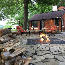 The back patio and the fire pit in the backyard of the travel lodge at The Vineyard Suite.