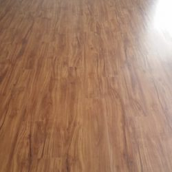 Long strip of newly installed wood laminate flooring