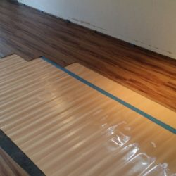 Wood laminate flooring installation underway
