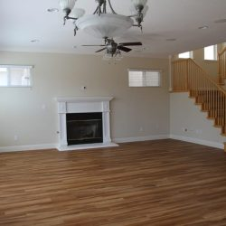 Large living room with newly installed wood laminate flooring