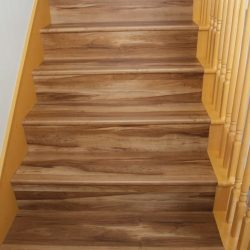Darker brown wood laminate flooring installed on stairs