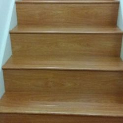 Oak colored wood laminate flooring on stairs