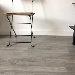 Detail view of grey wood laminate flooring in entertainment room