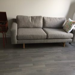 Grey wood laminate flooring in living room