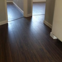 Two bedrooms with newly installed laminate wood flooring