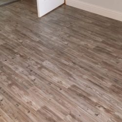 Freshly installed grey and brown wood laminate flooring