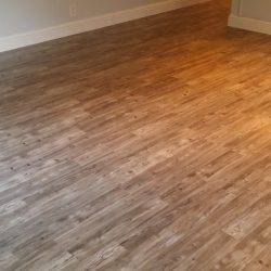 Warm brown laminate wood flooring installed in large room