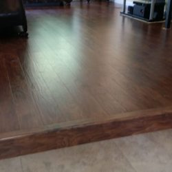 Newly installed wood laminate flooring with single step