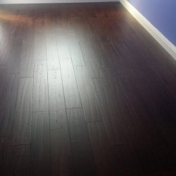 Dark brown wood laminate flooring freshly installed