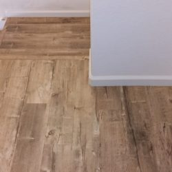 Wood laminate flooring installed on stairs and landing
