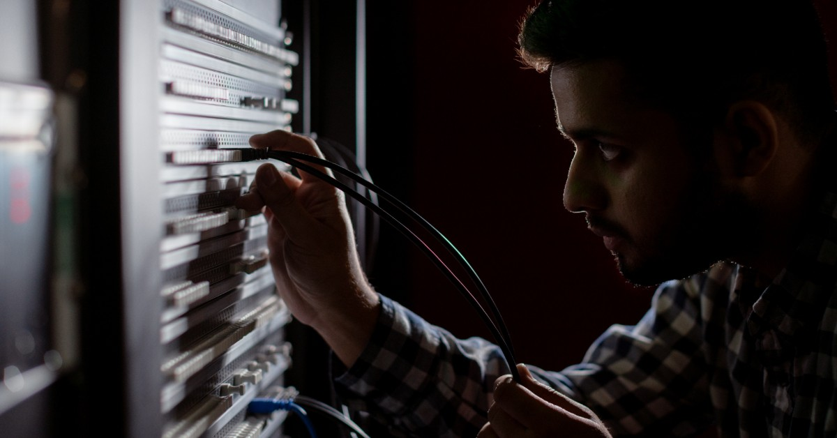 image of man looking at computer switchboard