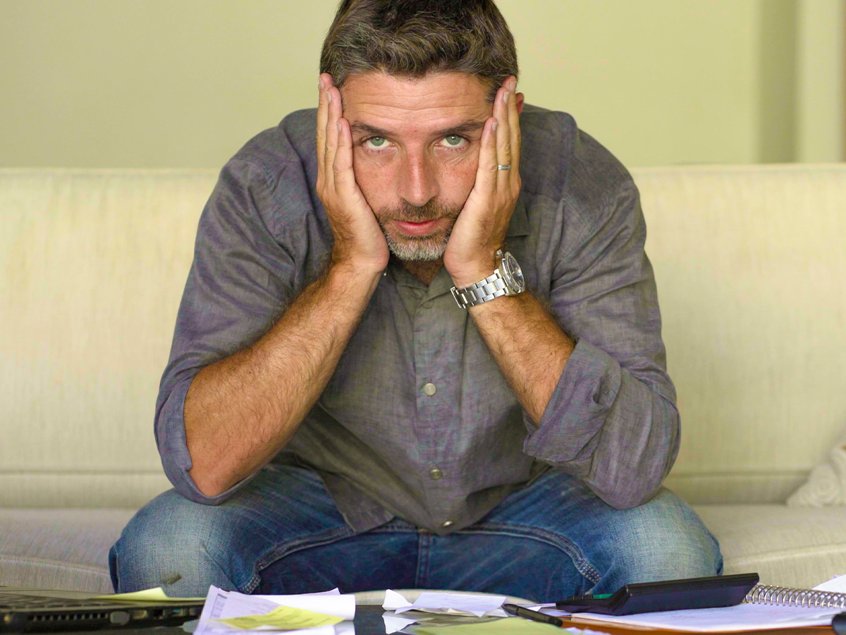 Stressed man going over finances.