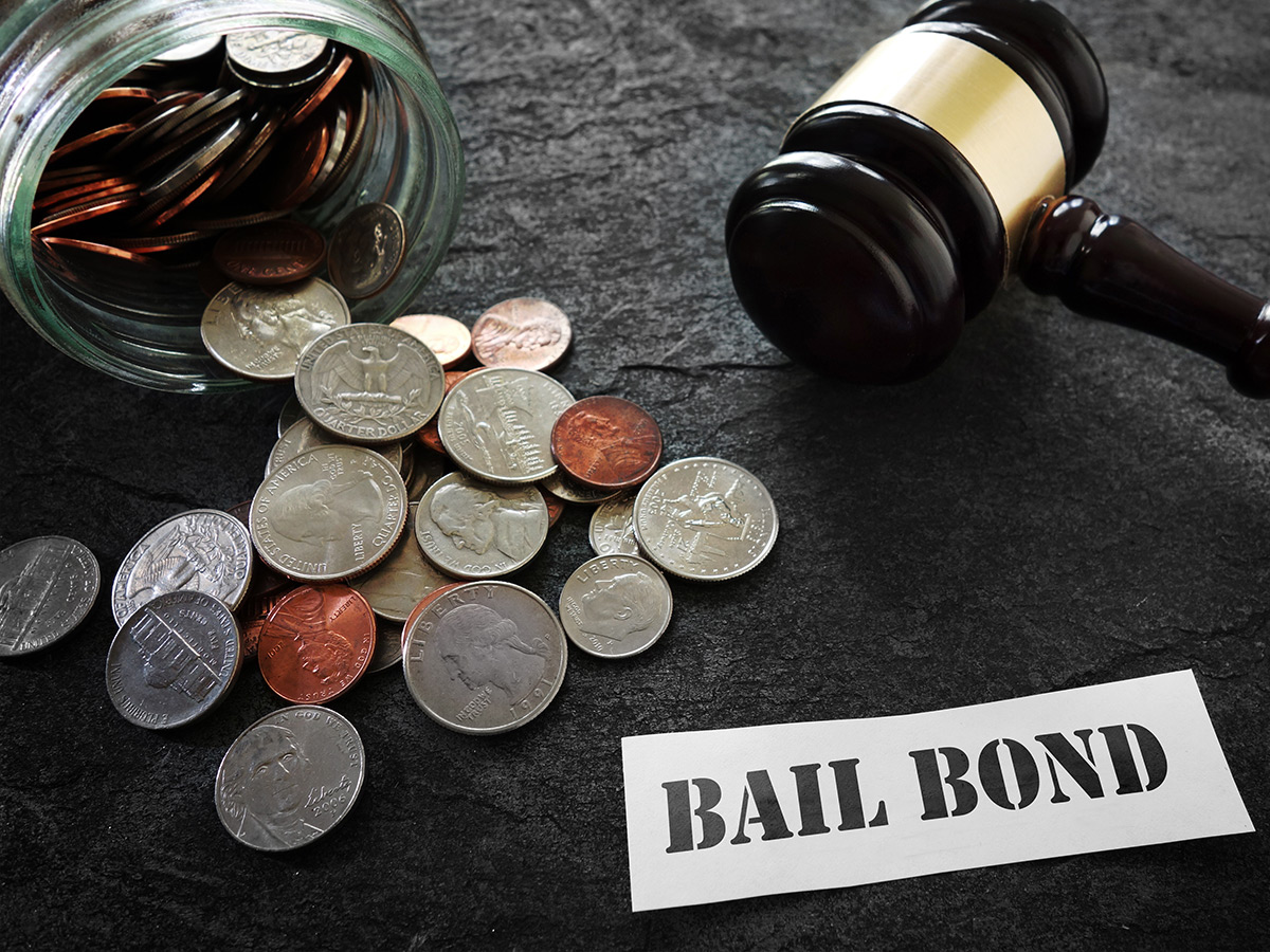 """Money and gavel with paper that reads """"bail bonds."""""""