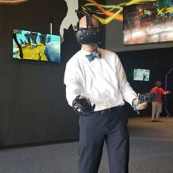 Person playing VR visible on the screen