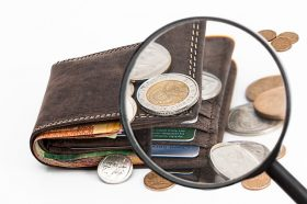wallet with magnifying glass citing investment