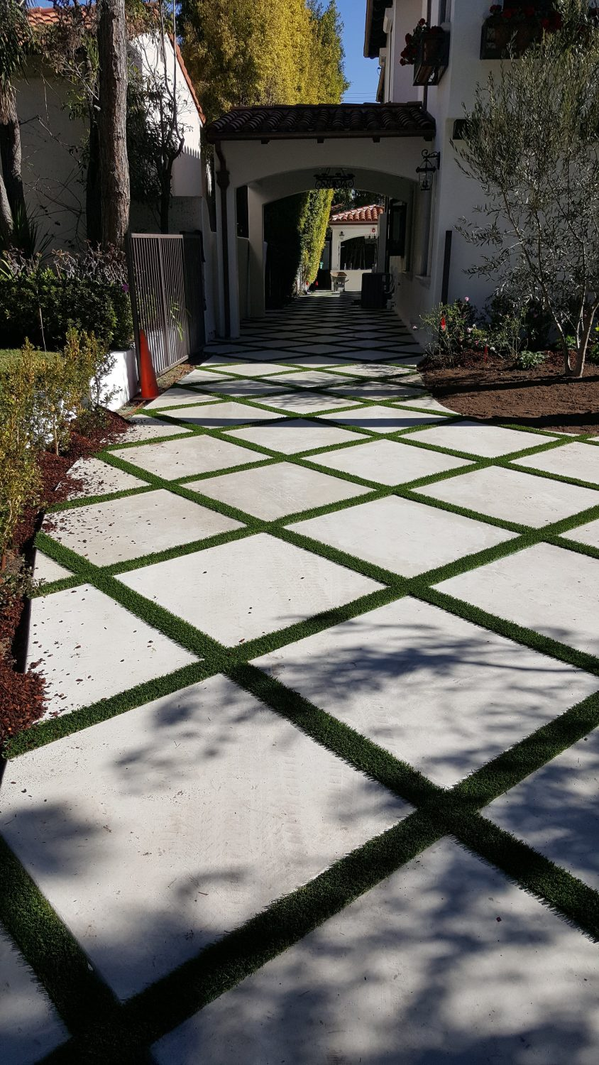 Image of Winding Turf Strip Driveway Leading Up To Home Entrance