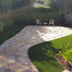 Image of outdoor patio with turf along the borders