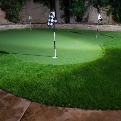 Image of artificial putting green at night