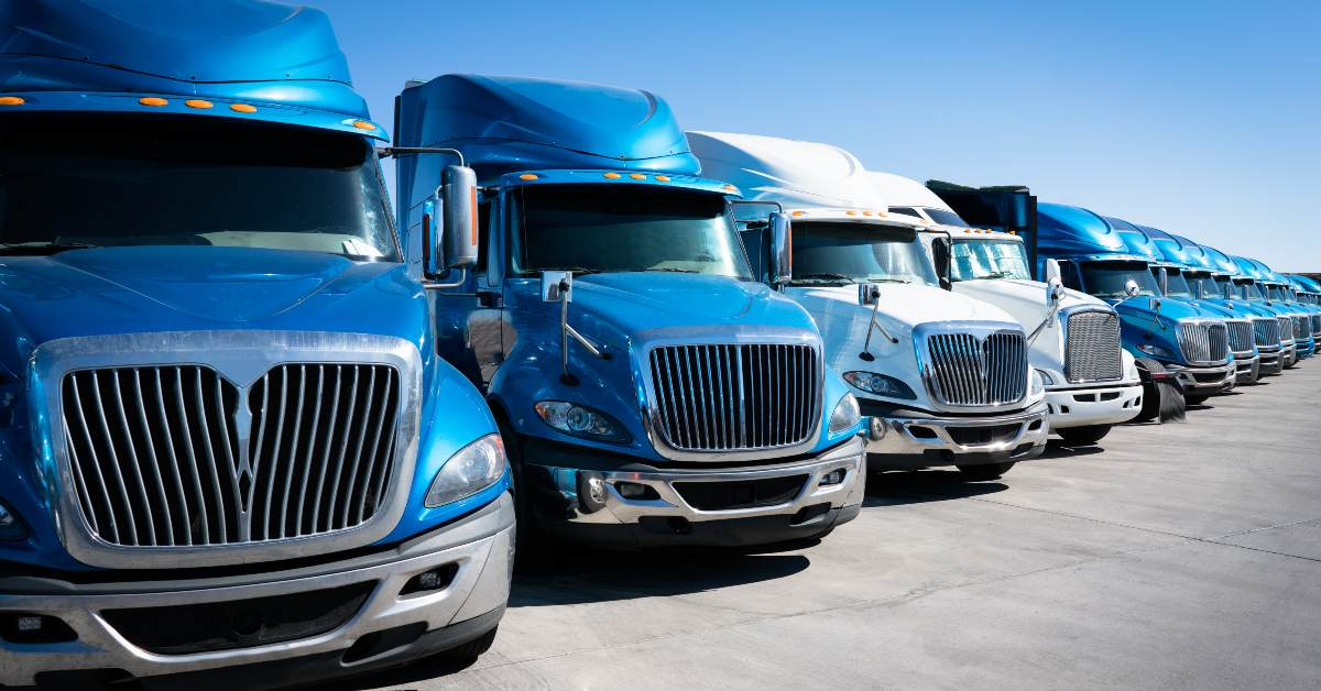 A fleet of semi trucks, perfect candidates for windshield replacement services.