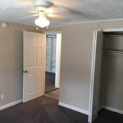 Bedroom with closet and view to dining room at Hickory Mills - Kent's Best Apartments