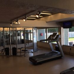 Treadmills and weights equipment at Kent's Best Apartments