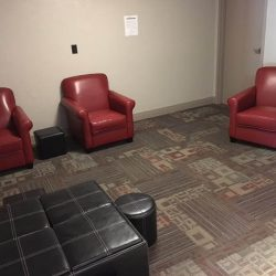 Fitness center seating area at Kent's Best Apartments
