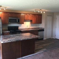 Large kitchen with island and updated cabinets - Kent's Best Apartments