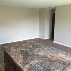 Apartment with kitchen island and open dining room - Kent's Best Apartments