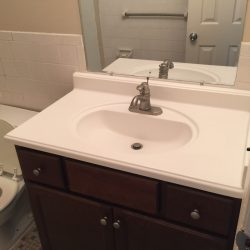 Apartment bathroom with vanity - Kent's Best Apartments