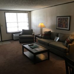 Large living area and door to outside - Kent's Best Apartments